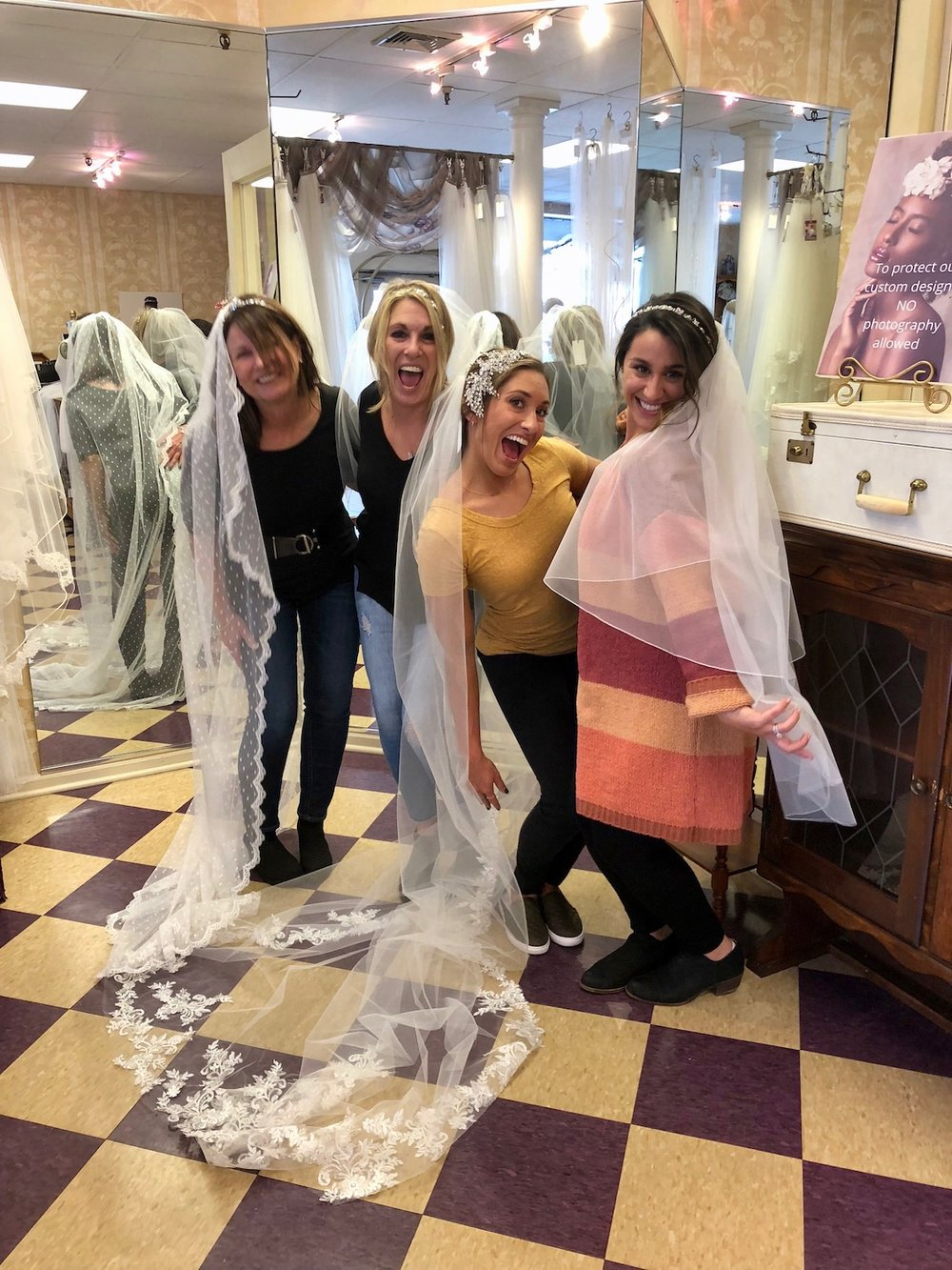 This photo says it all. Breeanna's entire entourage wanted to try on a veil and headpiece. They were so much fun to work with and open to other ideas.