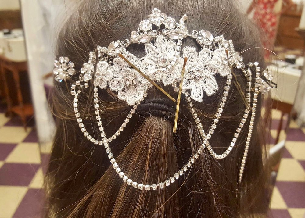"This is our ""Grace"" headpiece modified and worn as a backpiece with rhinestone draping."
