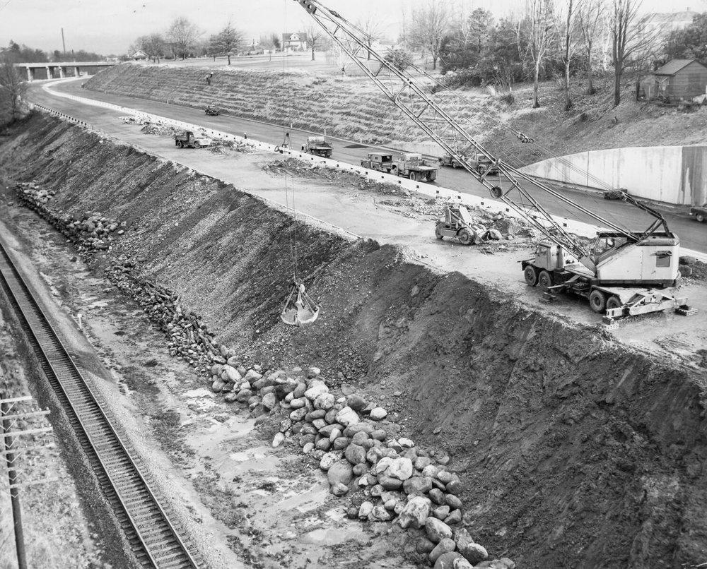 1957 Banfield, repairing slide damage, Lloyd Golf Course upper right. OHS   bb015411