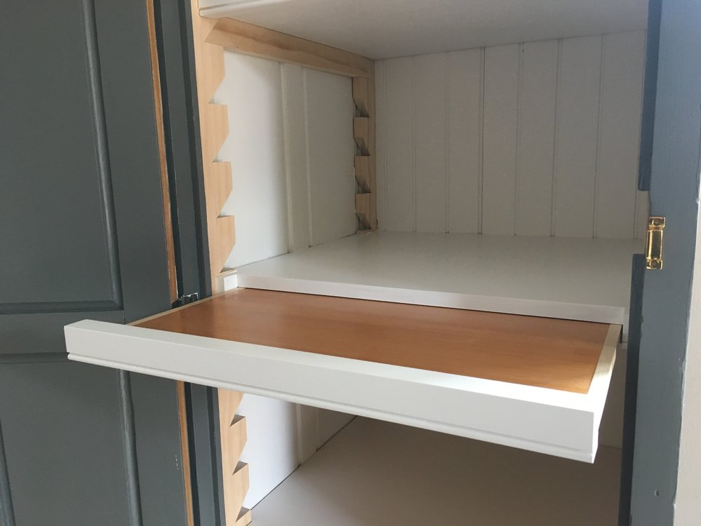 Hidden pull-out looks like all the other shelf nosings!