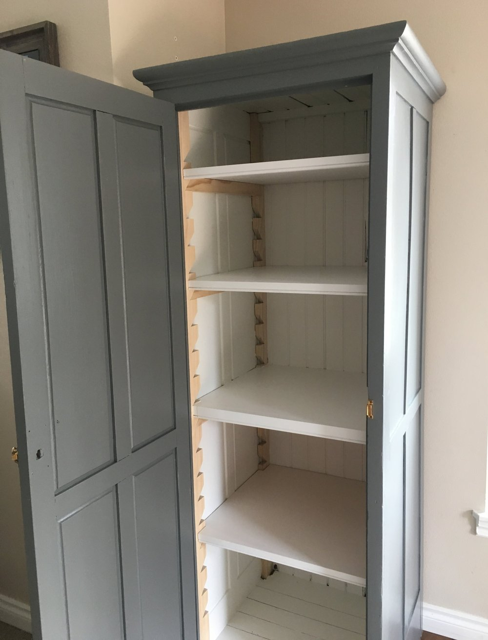Antique Cabinet outfitted with Zig-Zag shelving. Interior paint- SW Simple White. Exterior Paint- SW Westchester Gray.