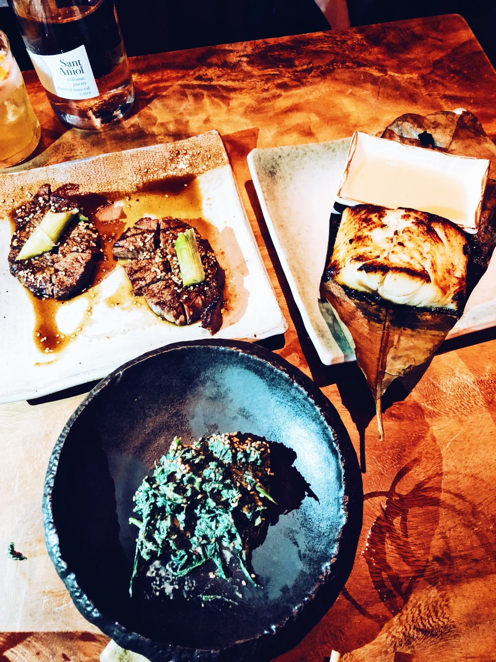 Wagyu beef fillet with a miso black cod & a side of sesame spinach -