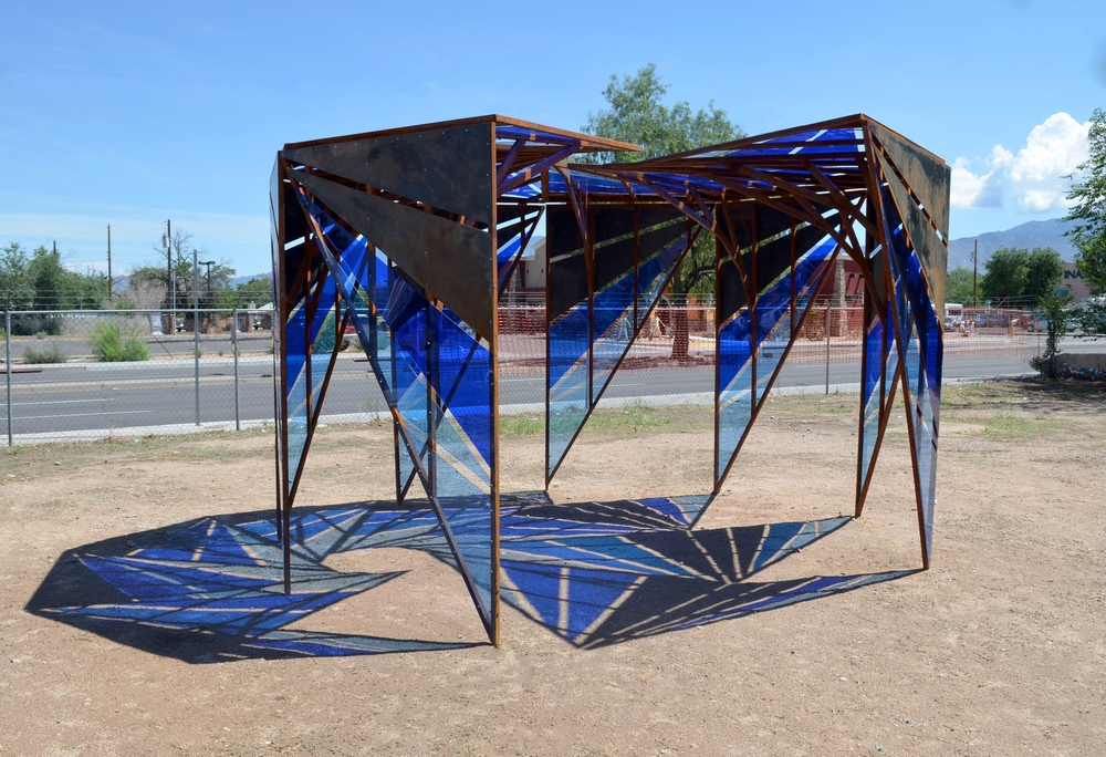 Morning Glory  was part of a larger project called Stories of Route 66: International District, engaging residents of Albuquerque's International District in collaborative art, creative placemaking, community development and transforming neighborhood spaces.A permanent version with more durable materials has been installed in it's new location at the Sundowner. 2014-2017. More pictures in the new location to come.Additional information   here  .