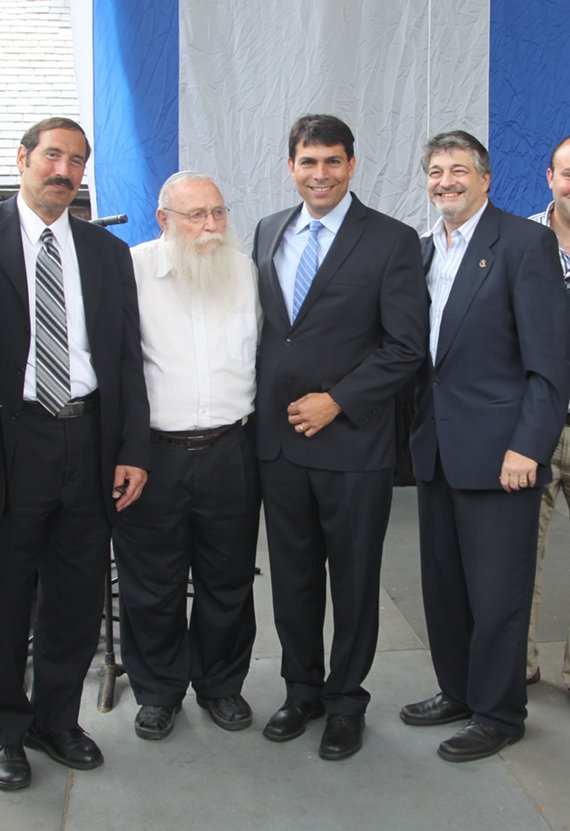 Left to right. Dr. Joe Frager organizer of the concert , Rabbi Haim Drukman, MK Danny Danon, and Dr. Paul Brody, chairman of the concert. Photo Courtesy of BarryBrownStudios.com