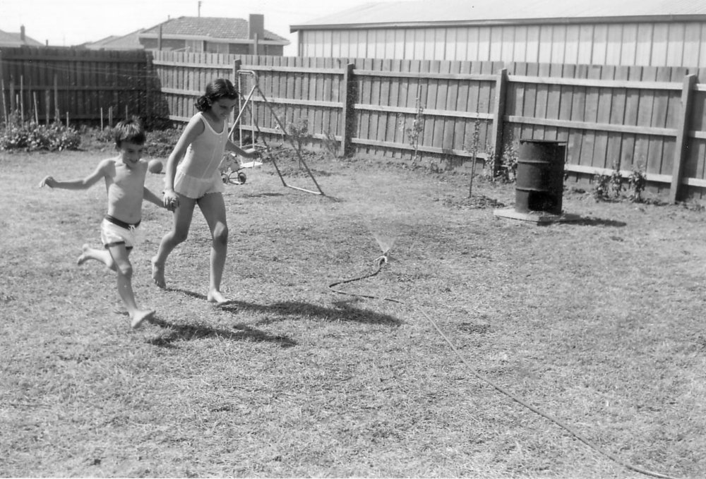 With my little brother in the back yard of our home in Melbourne, Australia.