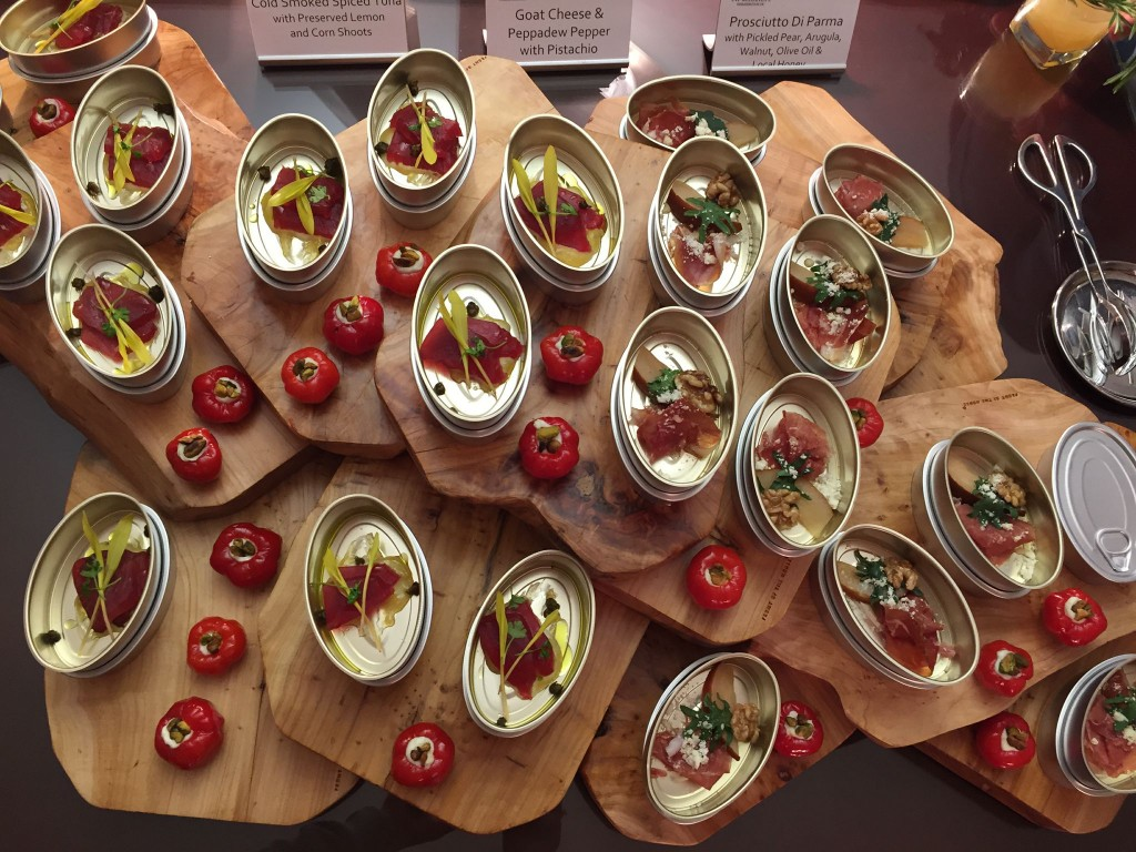 Tins of appetizers, including cold-smoked tuna and prosciutto di Parma, flecked with goat cheese- filled Peppadew peppers-- a sweet piquanté variety grown in the Limpopo province of South Africa.