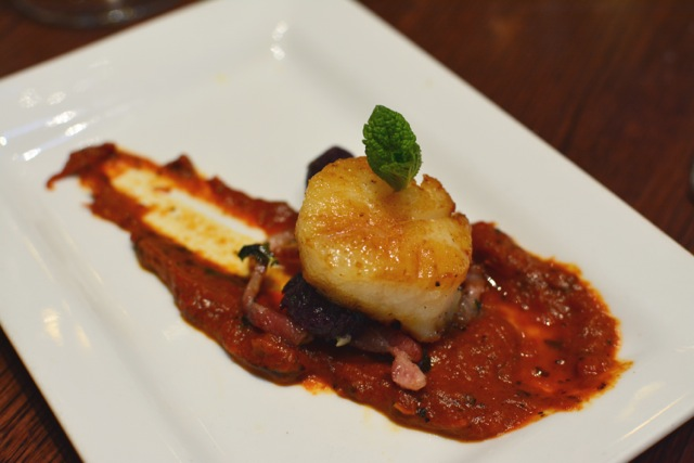 sautéed housemade purple sweet potato gnocchi and pan-seared scallops