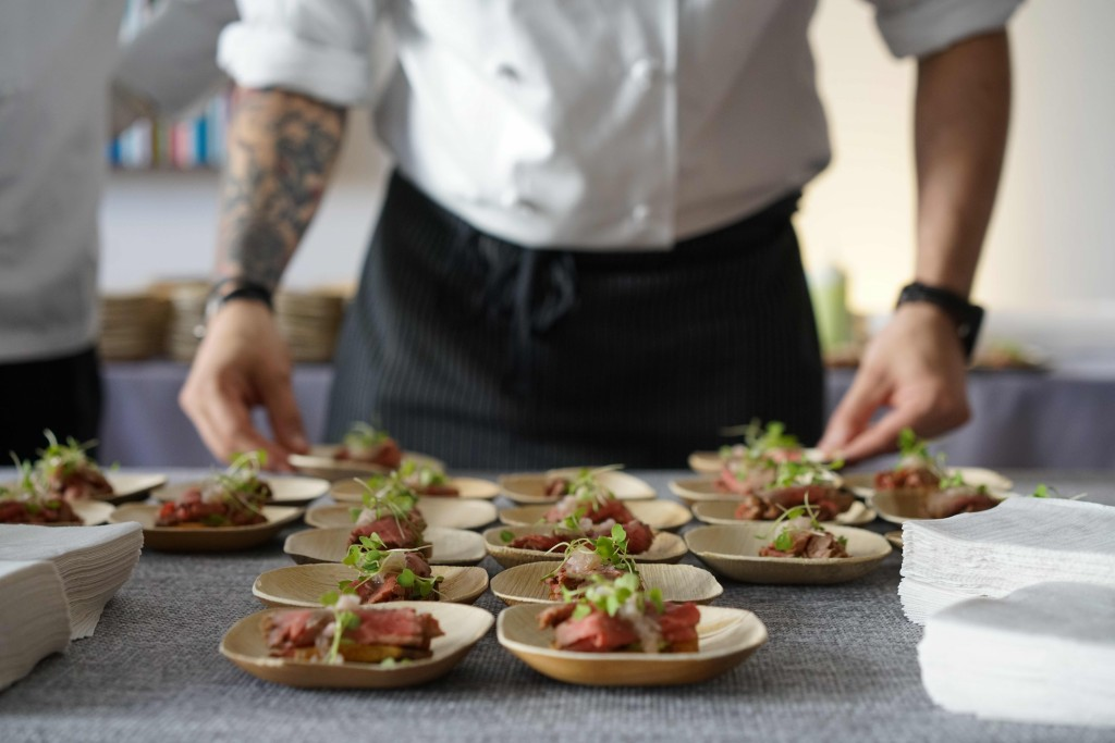 Chef Ed Scapone, from DBGB DC, plating his Seven Hills Farm beef with ramps on crostini.