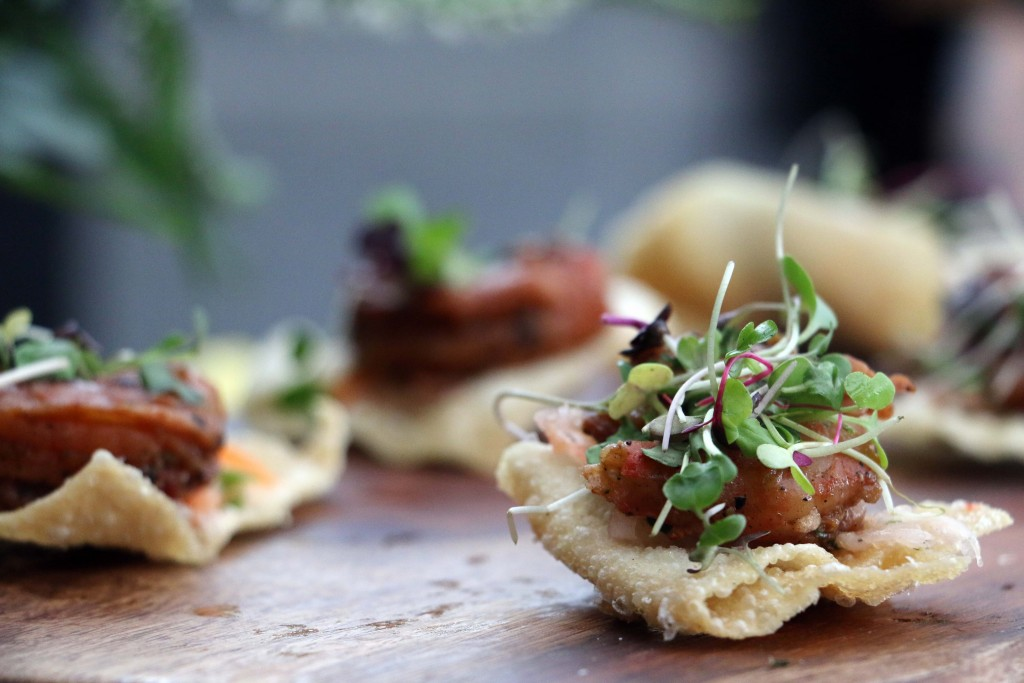 These white sesame shrimp with daikon carrot slaw on a crisp wonton were paired with locally inspired punches at the Columbia Room patio. (Photo by January Jai)