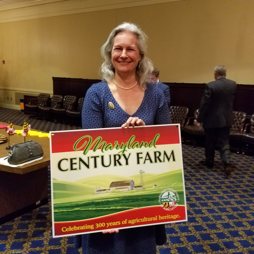 "Jennifer Tilghman Cholnoky accepted her family's recognition for ""The Hermitage"", a farm owned and operated by her family for 300 years in Maryland's Queen Anne County. Cholnoky's father still lives on the farm and grows corn, soybeans, winter wheat and rapeseed."