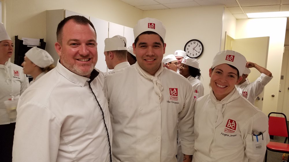 Chef Cedric Maupillier greets his two new L'Acadmie interns, Mike Ferguson and Angela Jensen, who will be working at his restaurant, Convivial, for the next six months.
