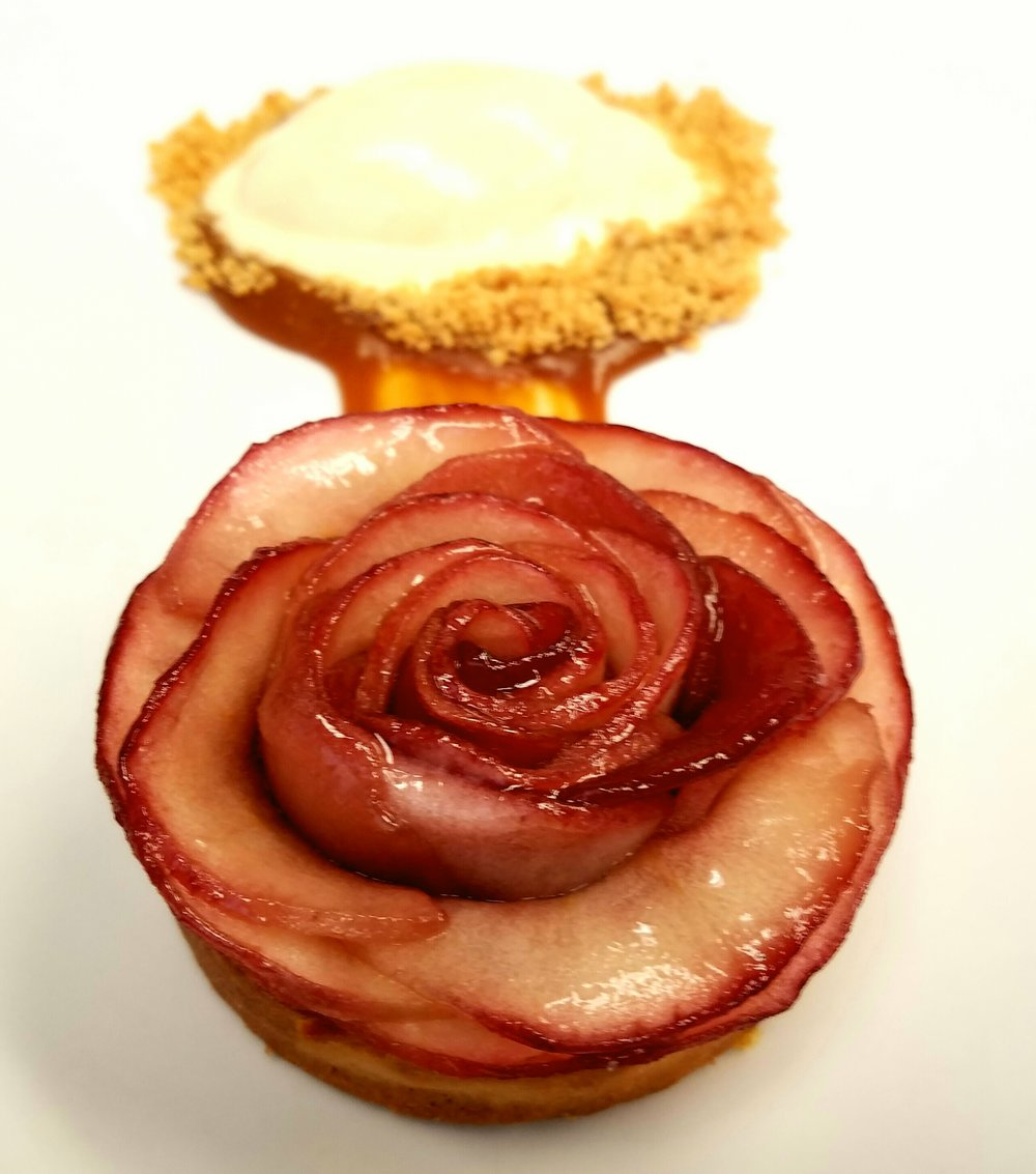 "Very pretty dessert presented by LADC's Team ""G"". A poached apple tartlette with spiced ice cream and caramel sauce."