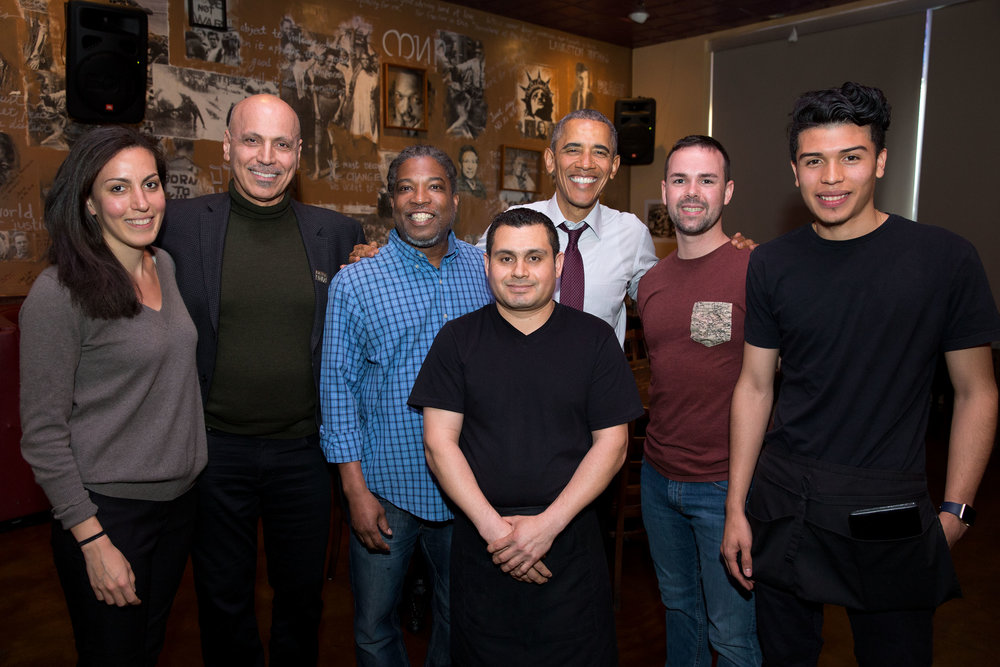 President Barack Obama greets restaurant staff after a lunch time meeting with formerly incarcerated individuals who have received commutations, at Busboys and Poets in Washington, D.C., March 30, 2016. (Official White House Photo by Pete Souza)