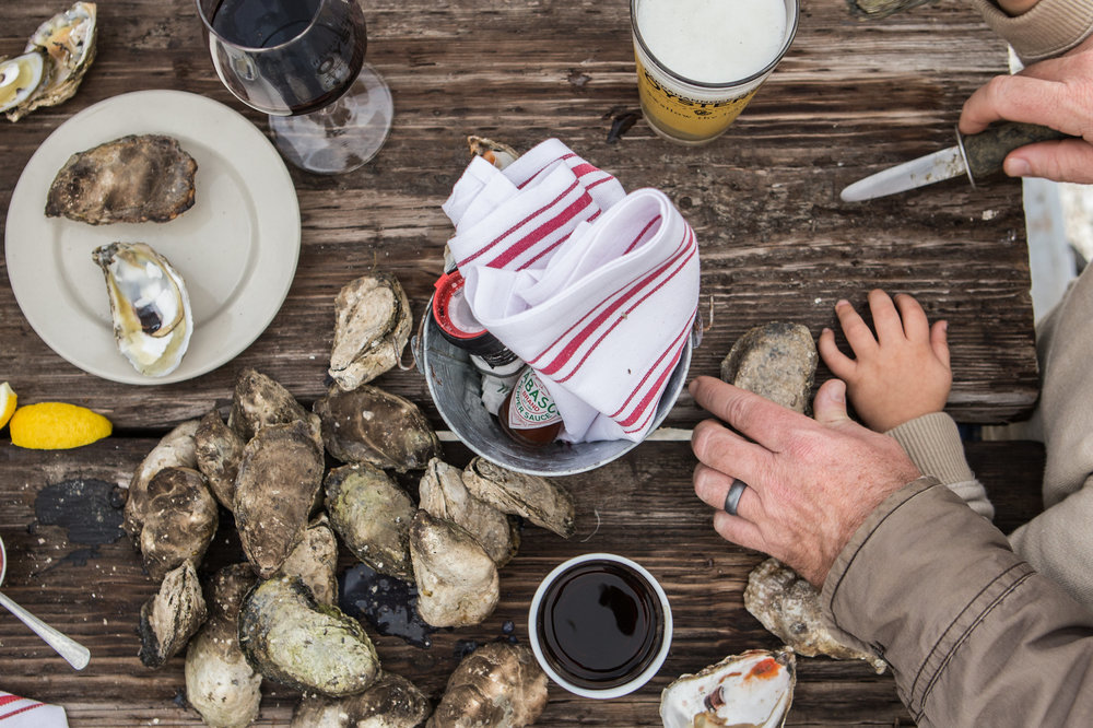 Two generations of Croxtons enjoy the bounty of a Tidewater oyster roast.