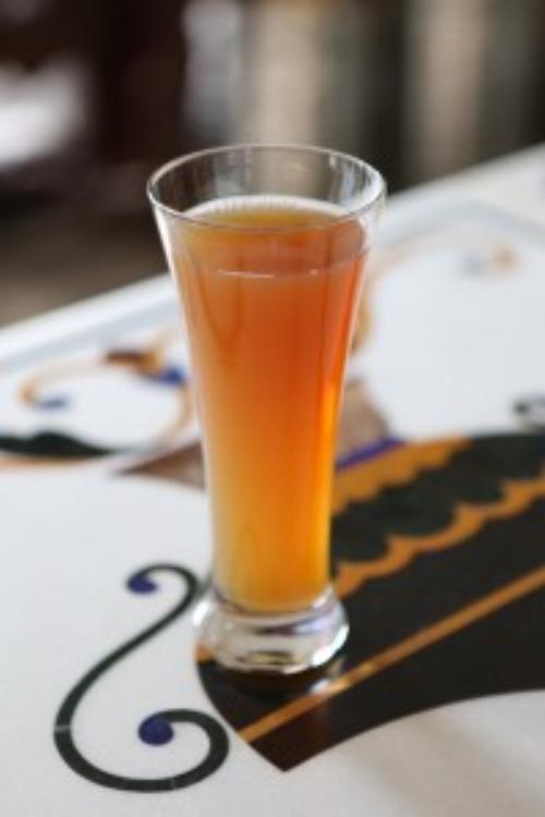 A glass of 100 jor bagh. hannah hudson photography
