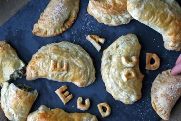 """Defined loosely, a hand pie is a circle of dough stuffed with a sweet or savory filling, folded into a half-moon shape, and crimped along the edges,"" Susan Lutz writes."