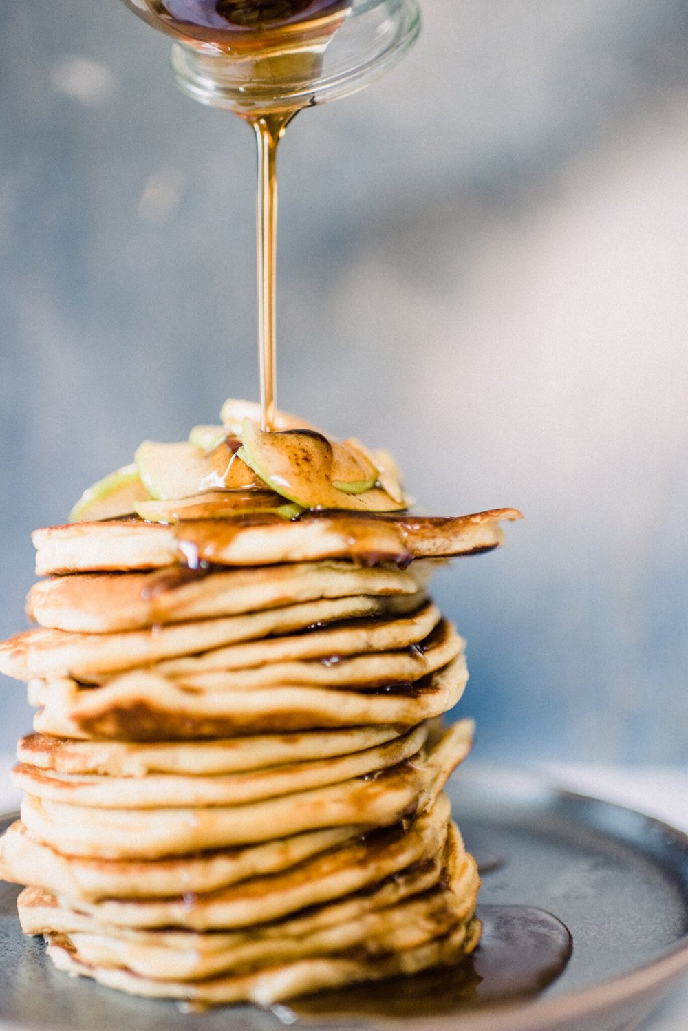 Maple syrup or honey pair perfectly with these apple pancakes.