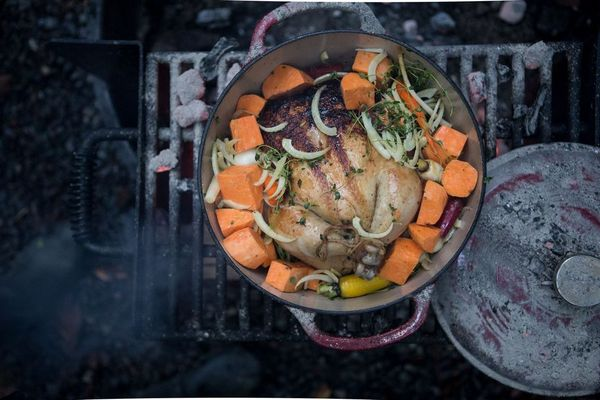 Rainbow carrots and sweet potatoes add a splash of color to this roast chicken.