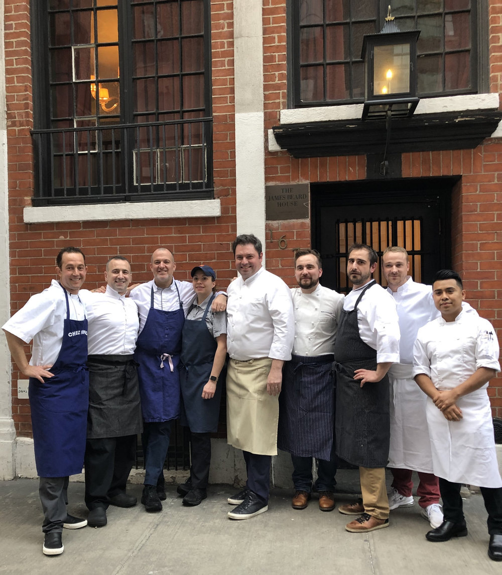 A gathering of french chefs from dc and baltimore and their assistants, in front of the james beard house in greenwich village.