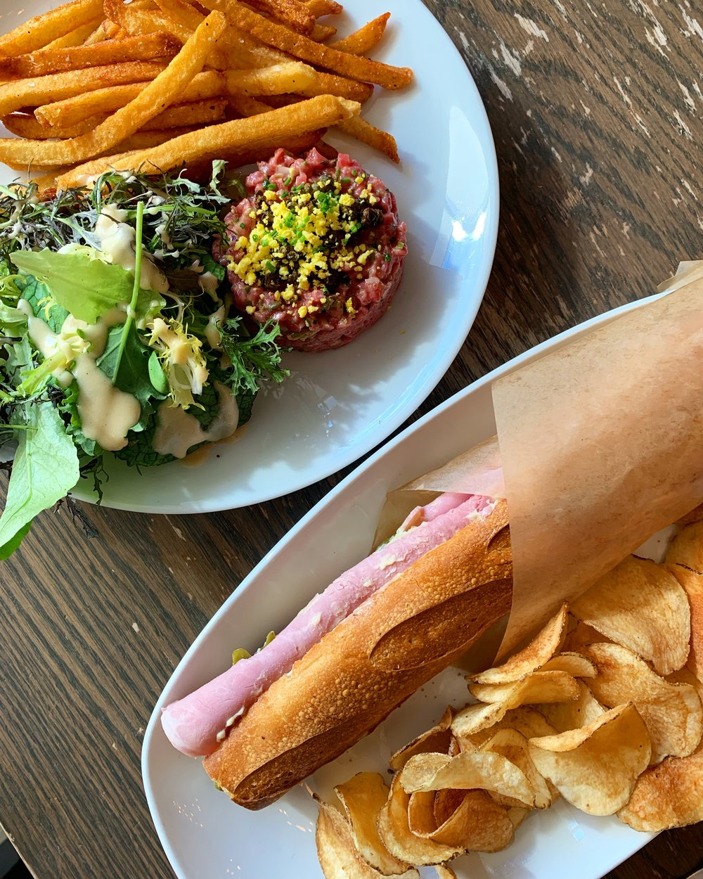 Two delicious classics on the lunch menu at convivial, beef tartare and jambon beurre with homemade chips. @convivialrestaurant Photo by AJ Dronkers.