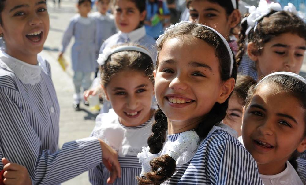 UNRWA Declares School Year Open    Statement by UNRWA Commissioner-General Pierre Krähenbühl on the 2015/16 school year    East Jerusalem   I am pleased to declare the 2015/16 UNRWA school year open. Students will return to school according to plan in Palestine on 24 August, in Jordan on 1 September, in Lebanon on 7 September and in Syria on 13 September.  I have taken this decision first and foremost because of how central education is to the identity and dignity of Palestine refugees and of the 500,000 boys and girls whose future depends on learning and developing skills in our 685 schools. It is on the benches and behind the desks of UNRWA classrooms that millions of Palestine refugees, deprived for so long of a just and lasting solution, have built the capabilities and shaped the determination that enabled them to become actors of their own destinies.  Education is a fundamental right for children everywhere in the world, and it should never have come to the point where the UNRWA school year risked being delayed because of a funding shortfall for our core budget. But it almost did. For this reason we fought very hard to create a revival of solidarity for Palestine refugees and a renewed understanding of the importance of respecting their rights and addressing their needs adequately and predictably.  For months UNRWA has been drawing the attention of the international community to the risks of neglecting the fate and plight of Palestine refugees in an increasingly unstable Middle East. Faced with the multiplicity of crises in the region, many were on the verge of purely and simply overlooking or forgetting the humiliation and despair endured for decades by Palestine refugees. UNRWA has insisted time and time again that this is a risk the world cannot take. We also heard the serious concerns expressed by host countries and the refugee community. The peaceful protests that took place over the past weeks showed solidarity and reminded the world of the importance of the work of UNRWA.  We also demonstrated strong resolve in these difficult weeks because we were not prepared to provide education services at a discount price. The UNRWA education programme is one of the best and most cost-efficient in the region. We insisted on guaranteeing students their rights, the full quality school year, and education staff their full salaries. For this, we needed to close the funding gap.  We began by taking significant internal measures to reduce costs and then engaged our partners, including host countries, member states and other donors, to overcome this major funding crisis and risk to the education programme. Our engagement included an extraordinary session of the UNRWA Advisory Commission and a special report to the Secretary-General, which was circulated to the General Assembly. The reactions and response we witnessed were remarkable. I wish to pay the warmest of tributes to a number of key countries and players involved in supporting us at this very difficult time.  We are deeply grateful to the governments of host countries for their active engagement in recent weeks. Particular recognition goes to the President and to the Prime Minister of the State of Palestine; to the Prime Minister and to the Deputy Prime Minister and Foreign Minister of the Hashemite Kingdom of Jordan; and to the Prime Minister of Lebanon. We thank them all for their trust, exemplary support and commitment.  We express profound appreciation to the Kingdom of Saudi Arabia, the State of Kuwait and the United Arab Emirates – whose remarkable combined contributions cover almost half of the 2015 deficit – and to the United States of America, Switzerland, the United Kingdom, Norway, Sweden and the Slovak Republic, who have together contributed generously to help address the funding shortfall.  The total amount of contributions received to date against the deficit of US$ 101 million is US$ 78.9 million (see details below). In addition to this, we welcome the efforts by the European Union to mobilize additional means in a few weeks' time and look forward to a positive decision. We note that two other countries are still seriously considering making their own donations. . While some significant work therefore remains, I consider that we have achieved our first objective and can open the schools.  We are deeply pleased by the outcome of our efforts and the combined efforts of many partners and supporters. We extend a special message of sincere gratitude to the United Nations Secretary-General and the Deputy Secretary-General for their strong support and personal engagement. We are also very appreciative of the support of the Special Coordinator for the Middle East Peace Process and of the Under-Secretaries-General for Political Affairs and Humanitarian Affairs.  At the same time, we are in pursuit of the second crucial objective and that is to place UNRWA on a more stable financial footing for the future. UNRWA will work actively in the coming months to take further internal measures to that effect. We will also actively engage and seek the support of hosts, member states and other donors for our internal measures and to achieve the goal of better protecting our human development activities, in particular our health and education services.  UNRWA will participate in a series of important meetings with its partners, for example at ministerial-level meetings in September of the League of Arab States and at the United Nations General Assembly, to identify concrete ways to improve our future financial stability.  In our hearts, we knew that there would be no rest until the day when we could announce the opening of UNRWA schools for the 2015/16 academic year. This was a priority of the highest order for all of us in the Agency. Now we turn our energy and focus to ensure that we never again reach the stage where core UNRWA services are at risk. It is a matter of dignity and respect for Palestine refugees and their children. My determination and commitment in this regard and in protecting the mandate of UNRWA is absolute.   Donations (US$):   Kingdom of Saudi Arabia: 19 million (confirmed on 12 August)  State of Kuwait: 15 million (confirmed on 17 August)  United Arab Emirates: 15 million (confirmed on 18 August)  United States of America: 15 million (confirmed on 18 August)  Switzerland: 5.15 million (confirmed on 30 July)  United Kingdom: 4.69 million (confirmed on 12 August)  Norway: 2.44 million (confirmed on 6 August)  Sweden: 1.7 million (confirmed on 19 August)  Slovak Republic : 0.05 million (confirmed on 25 July)   In addition (US$):   Al-Khair Foundation: 0.72 million (confirmed on 20 July)  Basque Government: 0.11 million (confirmed on 30 July)   BACKGROUND INFORMATION   UNRWA is funded almost entirely by voluntary contributions, and financial support has not kept pace with an increased demand for services caused by growing numbers of registered refugees, deepening poverty and conflict. As a result, the UNRWA General Fund, which supports core essential services and most staffing costs, operates with a large deficit. UNRWA emergency programmes and key projects, also operating with large deficits, are funded through separate funding portals.  UNRWA is a United Nations agency established by the General Assembly in 1949 and mandated to provide assistance and protection to some 5 million registered Palestine refugees. Its mission is to help Palestine refugees in Jordan, Lebanon, Syria, West Bank and the Gaza Strip achieve their full human development potential, pending a just solution to their plight. UNRWA services encompass education, health care, relief and social services, camp infrastructure and improvement, and microfinance.   For more information, please contact:    Christopher Gunness   Spokesperson, Director of Advocacy & Strategic Communications  Mobile: +972 (0)54 240 2659  Office: +972 (0)2 589 0267   c.gunness@unrwa.org    Sami Mshasha   Chief of Communications, Arabic Language Spokesperson  Mobile: +972 (0)54 216 8295  Office: +972 (0)2 589 0724  s.mshasha@unrwa.org