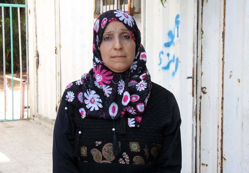 """Our house was totally destroyed during the conflict, and my family and I moved to an UNRWA collective center where we lived until they all closed in June 2015. In the collective center, I started working in various positions, as a handicraft teacher or as a cleaner for example. I was trying to give support and advice to the displaced. Living in the shelter was especially hard for women; they felt bored and anxious, and it was difficult for them to find privacy and a place to rest and be calm. I started to offer handicraft courses to give them a purpose and occupation to pass the time. When families started to move out of the collective center, I always felt happy and sad at the same time – happy because they would be able to gain their privacy back, but sad because over time, and in these difficult circumstances, we all became very close friends."" -Hekmat al-Faiomi, Women Committee Zaitoun Collective Center, Gaza, July 2015"