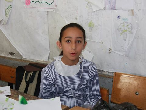 """I was so scared during and after the conflict. The sound of the bombing was always in my mind. The sound hurts a lot. Attending arts classes helped me to concentrate and feel peaceful. I like to draw happy faces and beautiful houses."" -Malak Musleh, 9-years-old, Gaza, May 2015"