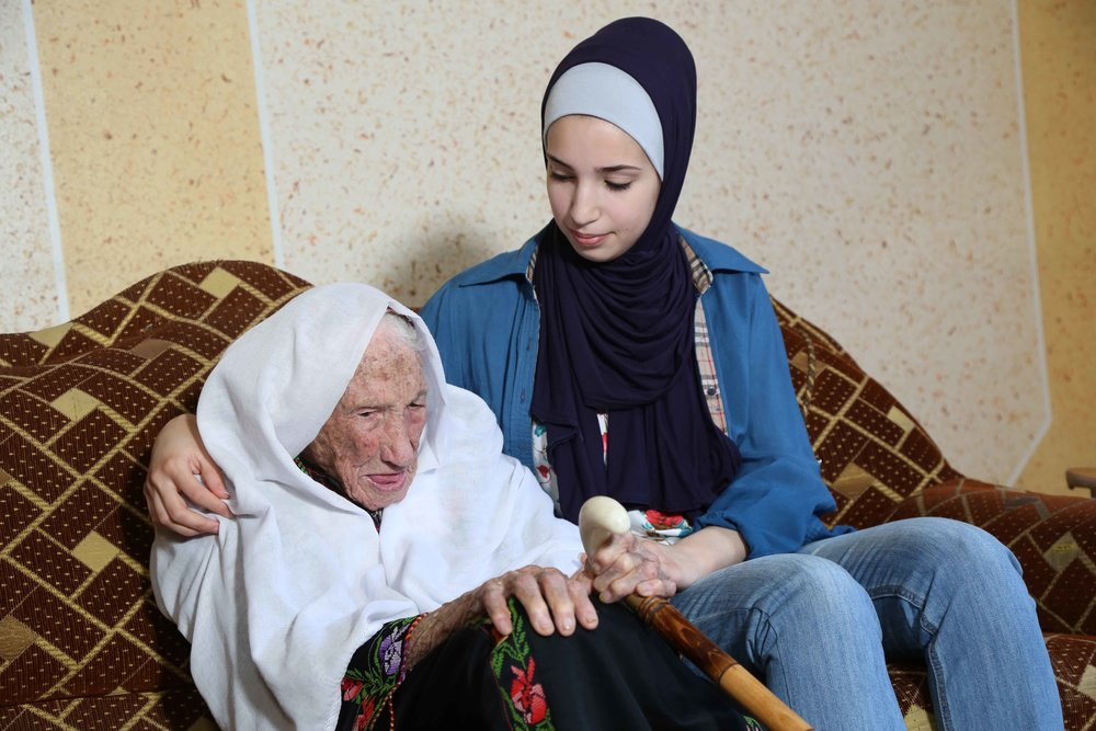 Haneen (19 years old) listens to her grandmother Hakma tell stories of life in Al-Swafeer. Hakma fled from her original village Al-Swafeer in 1948 when she was 35 years old. Nakba survivor and Palestine refugee living in Beach Camp, west of Gaza City.