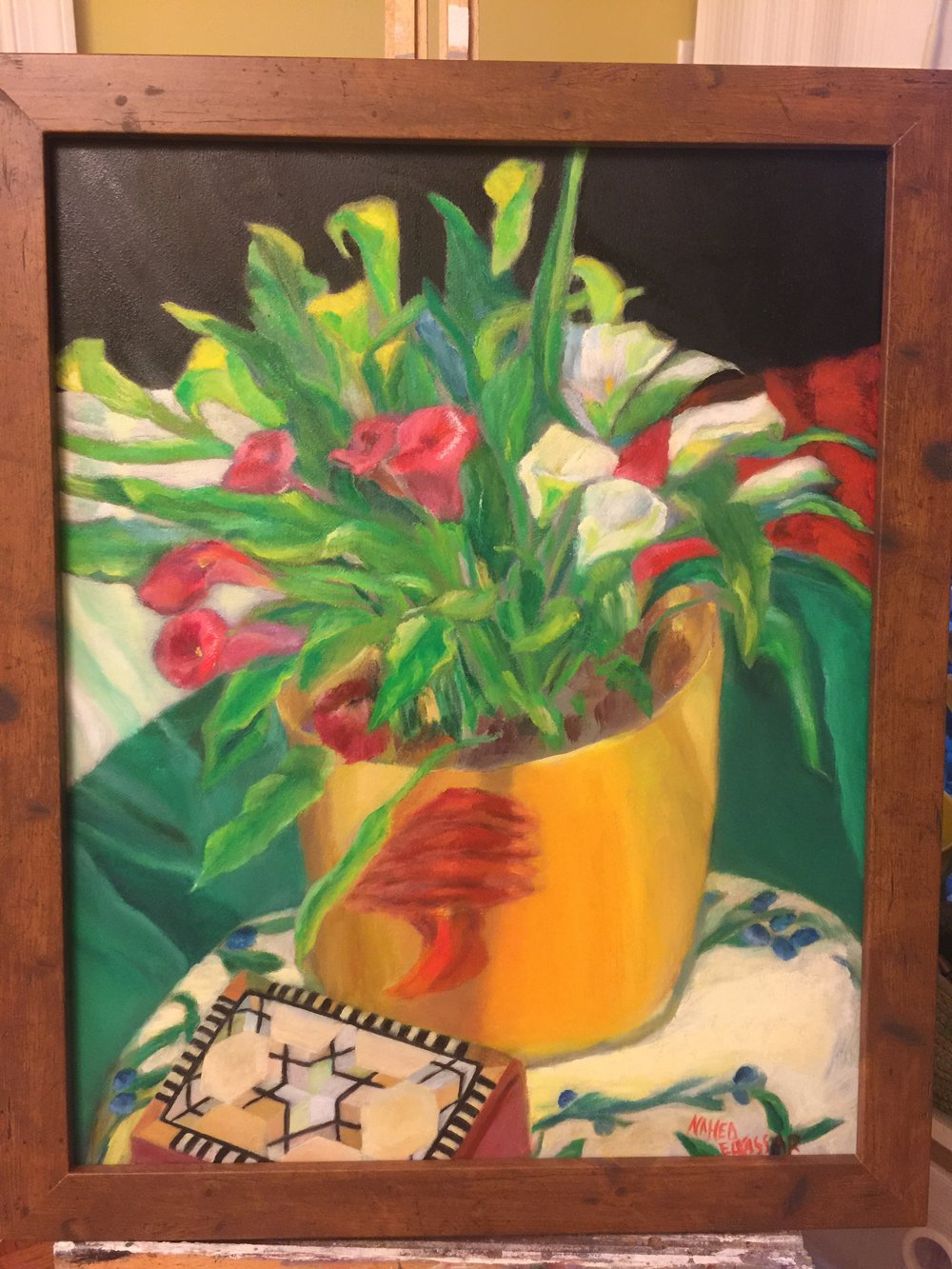 Inspired after the charitable iftar, Nahed created a painting highlighting symbols of the Palestinian diaspora and refugee experience, including a Palestinian flag, a vase with a Lebanese cedar, and a mother of pearl mosaic as a symbol of Syria.