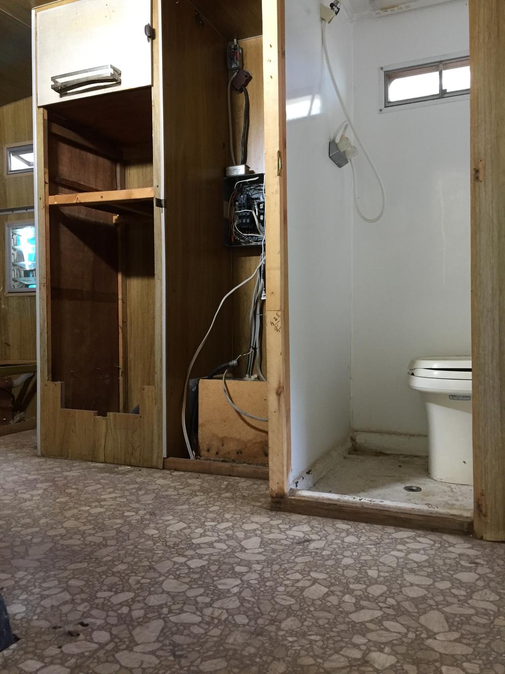 Mid-demo bathroom/storage closets