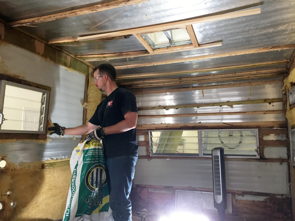 Mid-demo — Insulation removal process
