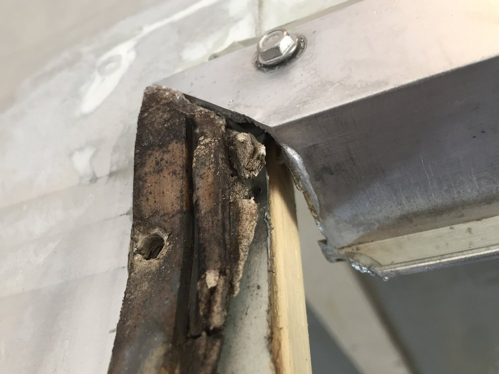 Exterior door frame – the original crusty putty tape, left vs. the new gray stuff underneath the polished frame on the top.