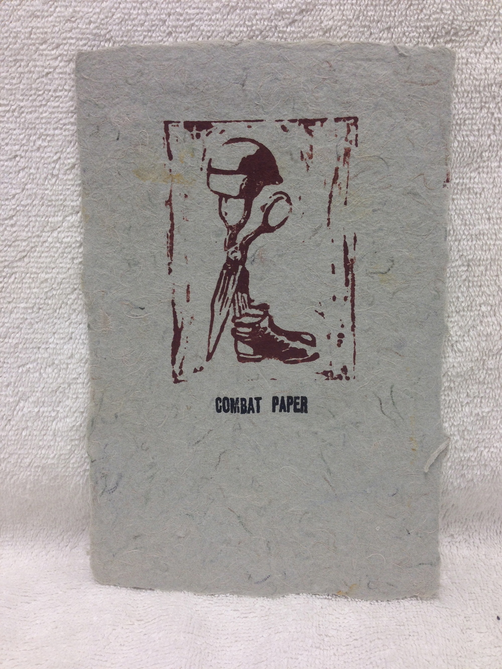 David Keefe Marines - Iraq _CPNJ Logo_ 2011 Lino-cut on Handmade Paper from military uniforms 8 x 5 PCNJ IMG_0952.jpg