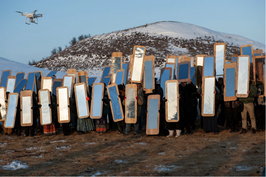 Water protectors with mirror shields (Photo credit: Cole Howard)