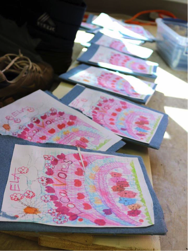 Handmade cookbooks, created by students in the Localvore special education program at Trumansburg Middle School. Photo by Laura Rowley.