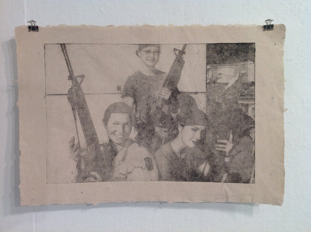 Jenny Pacanowski    Solarplate etching on handmade paper from military uniforms