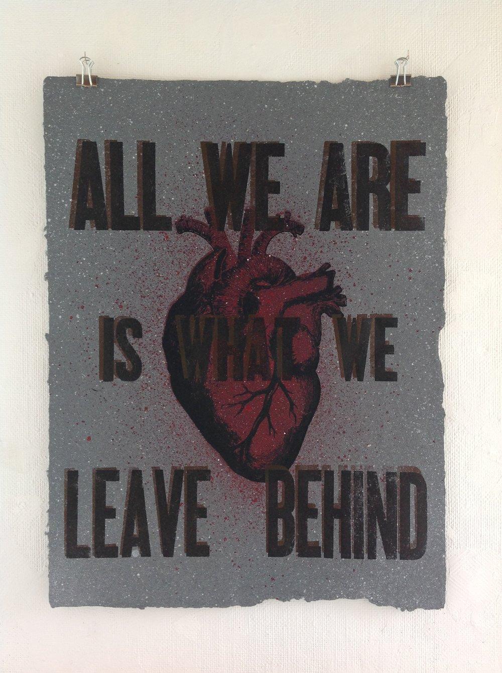 """All We are is What We Leave behind""    Eli Wright, 2017    Spray paint, Screen print, and Letterpress on handmade paper from military uniforms"