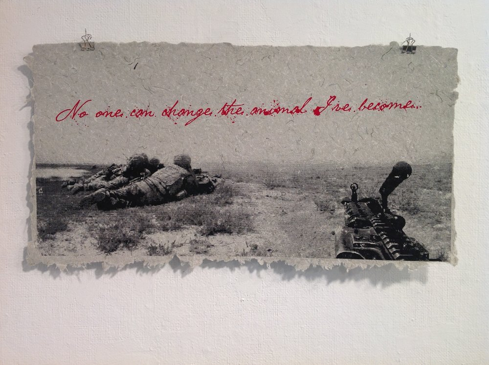 """No One Can Change the Animal I've Become""     Jesse Violante,  2013    Screen print on handmade paper from military uniforms"