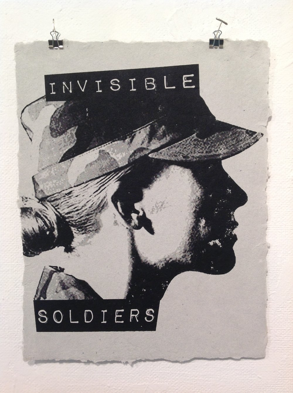 """Invisible Soldiers""    Anonymous    Screen print on handmade paper from military uniforms"