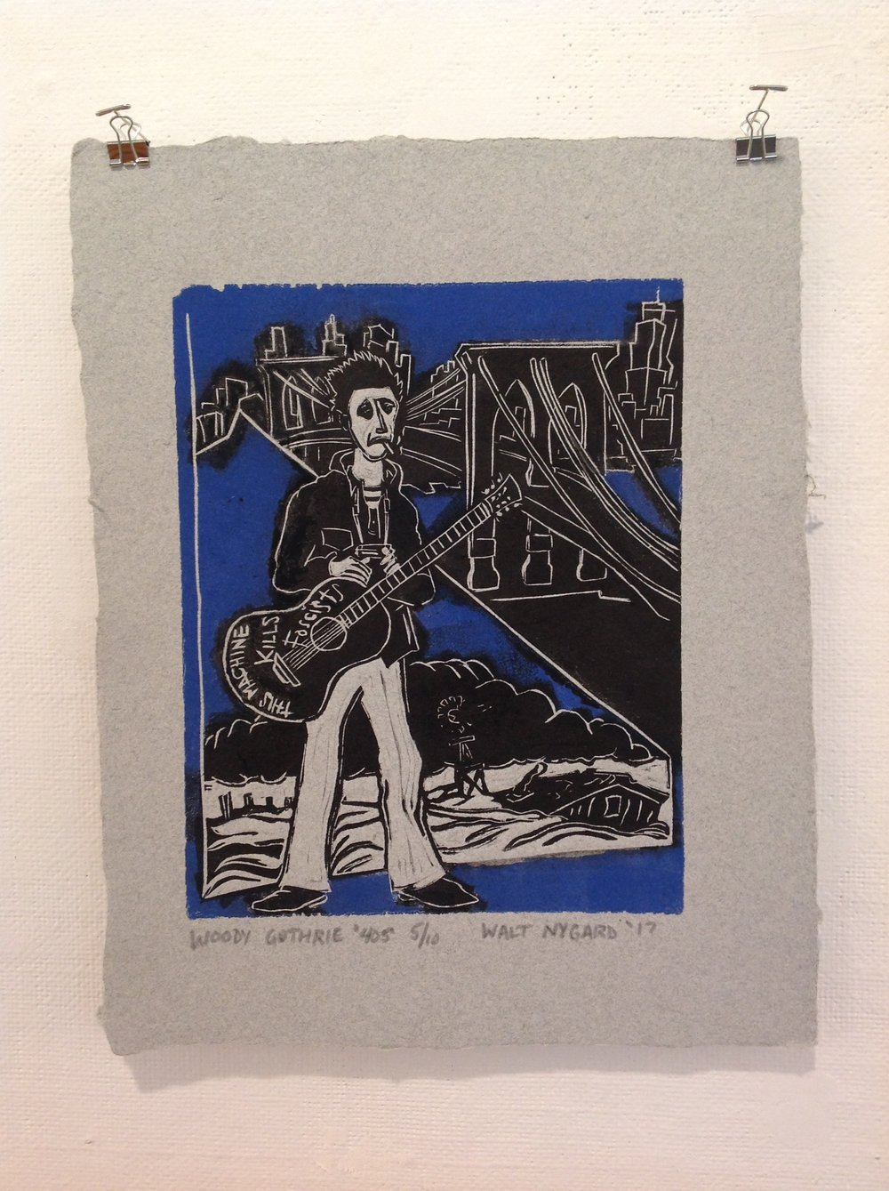 """Woody Guthrie 40's""    Walt Nygard,  2017    Linocut on handmade paper from military uniforms"
