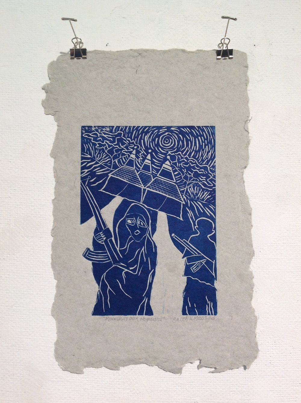 """Moonlight Over Mogadishu""     Sarah Mess,  2015    Linocut on handmade paper from military uniforms"