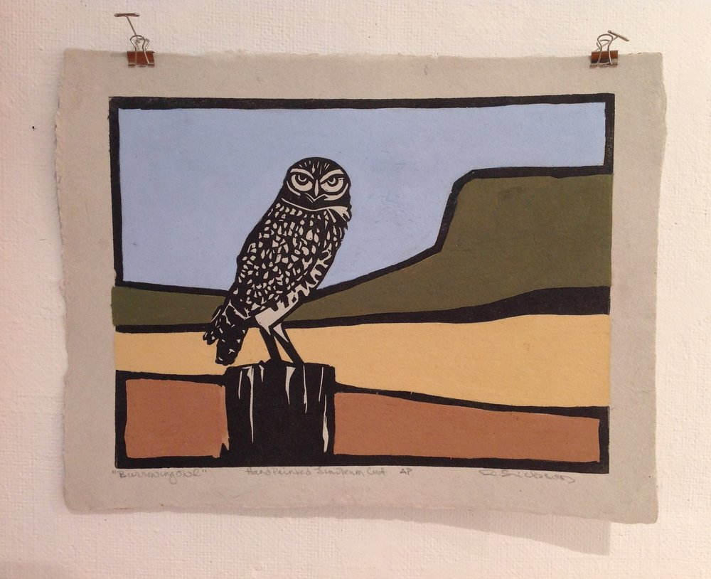 """Burrowing Owl""    Ron Erickson,  2018    Oil, Linocut on handmade paper from military uniforms"