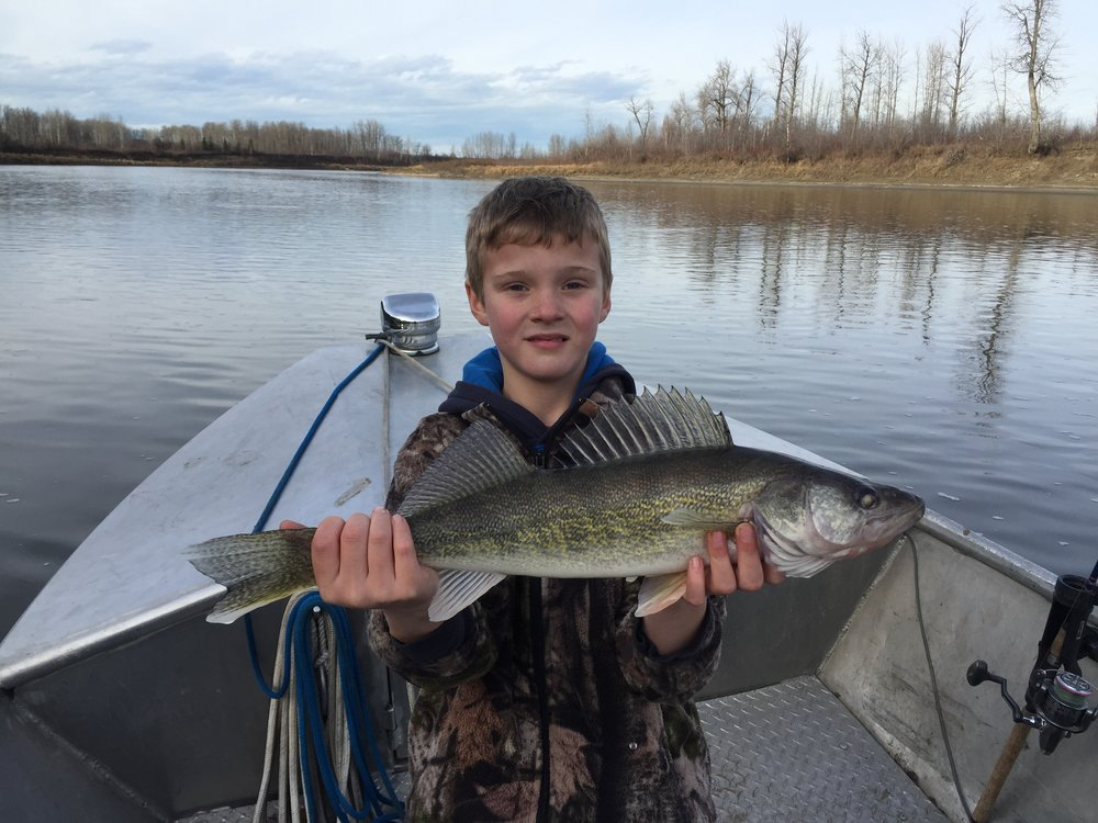 Young Brock and a great fall Walleye.