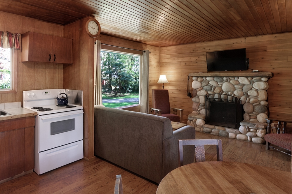 CABIN 9 - Two Bedrooms Tucked away in the garden featuring a beautiful river-rock fireplace.   From $169