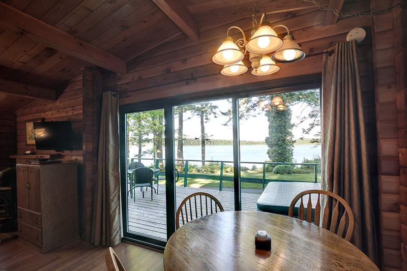CABIN 3 - Two Bedrooms Large living room windows accent the unobstructed oceanview.  From $199