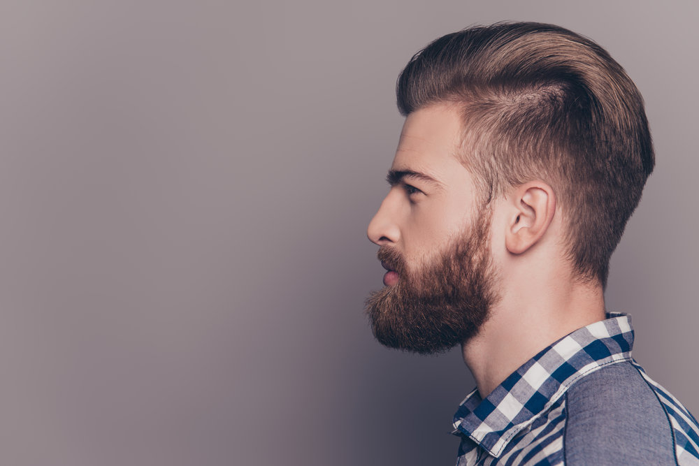 Side view portrait of handsome thinking stylish young man lookin.jpg