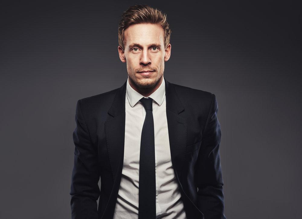 Portrait of handsome business man in dark suit.jpg