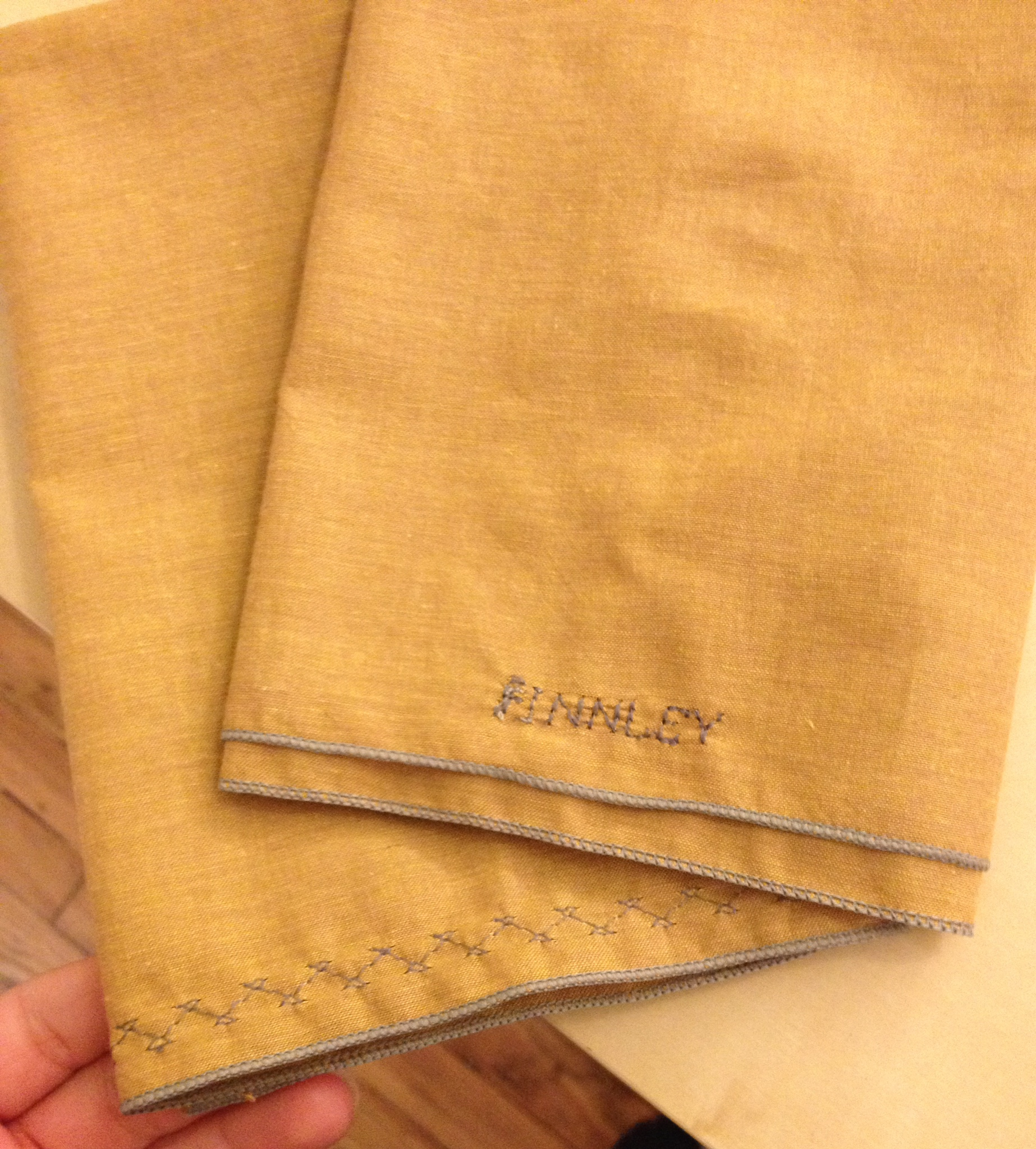 Personalized Holiday Napkins- Learn to use a serger, if you want. Make your holiday dinner extra special.