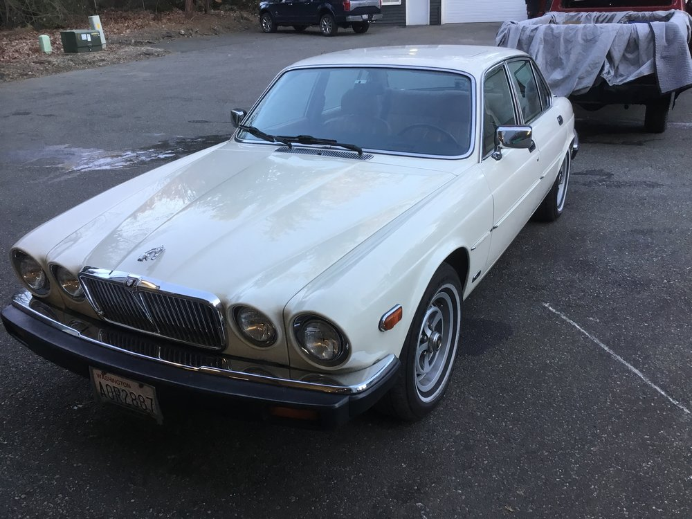 "1987 Jaguar XJ6<div class=""sold"">SOLD</div>"