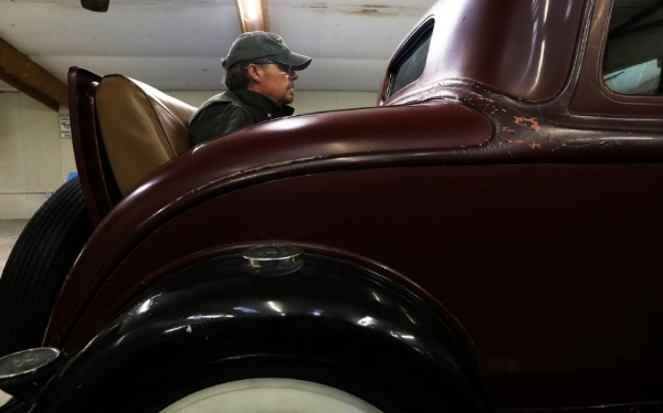 "Jim Sullivan's 1933 Plymouth PC is a rarity, with only about 8,900 having been produced. ""It's a survivor,"" Sullivan says of the six-cylinder, 90-horsepower coupe, designed for speeds of up to 40 mph. ""Roads were different then."" Riding in the rumble seat, prepare to be windblown. (Alan Berner/The Seattle Times)"